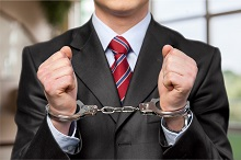 Handcuffed person in a suit