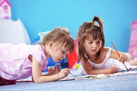 Two girls painting